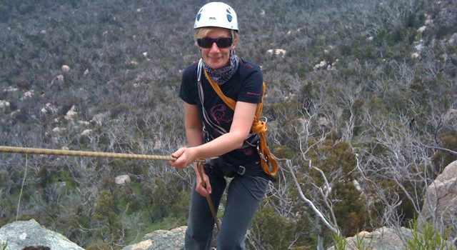 Fiona abseiling at Booroomba Rocks